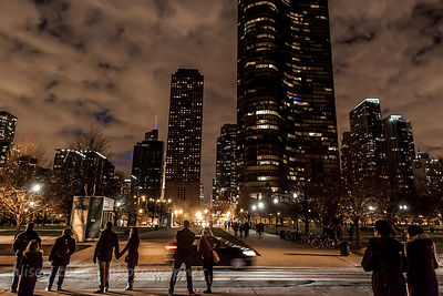 People walking away from Navy Pier, Chicago, in the evening