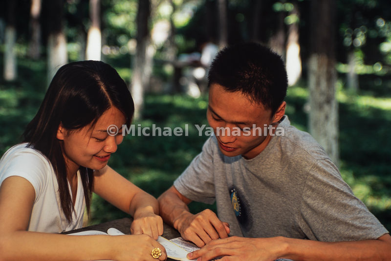 Students from East China Normal University study in the park and chat in Shanghai, China.