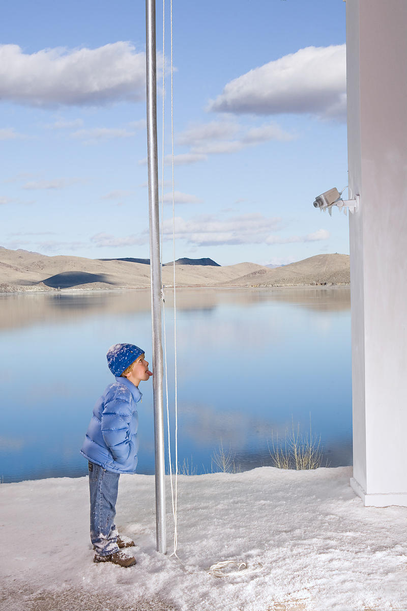 boy licking frozen flagpole