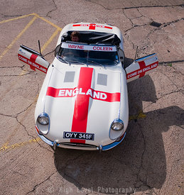 England Supporter with Etype Jaguar covered in England Flag for World Cup 2010
