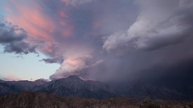Wide Shot: Pastel Sunrise Over the Eastern Sierras Following a Billowing Thunderstorm (Moving Camera Shot)