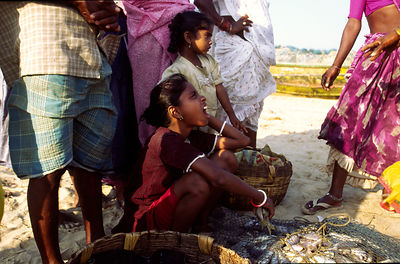 A child selling fish on Puri beach