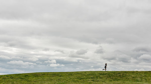 Danish boy running in a field 2