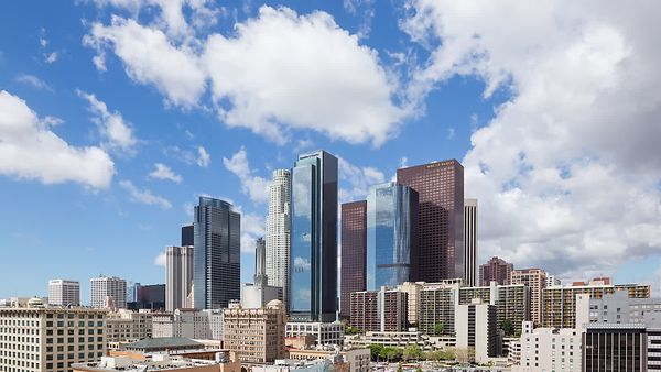 Medium Wide Shot: Moving Shadows Of Cumulus Over Reflective Glass, Steel & Concrete, Downtown L.A.