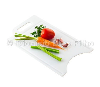 Cutting board with vegetables.