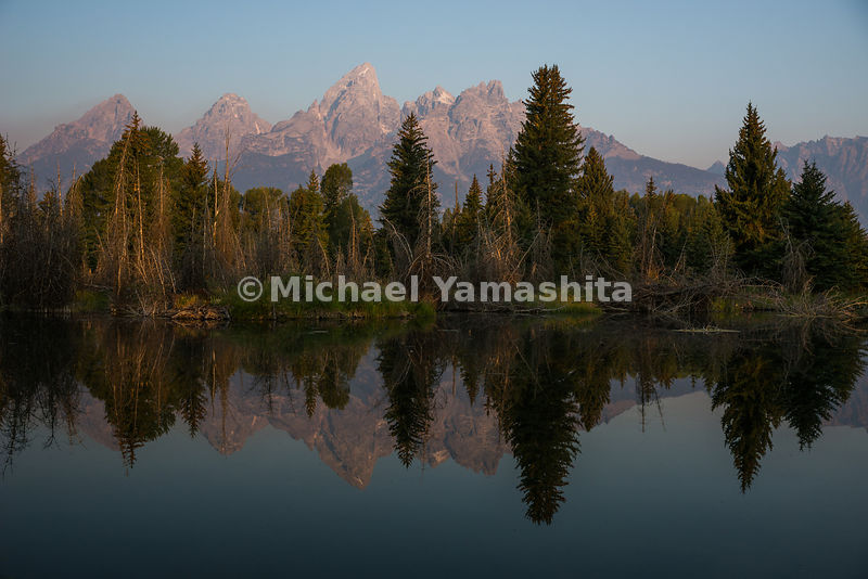 Sunrise view of the Teton Range and Snake Rier from Schwabacher landing. Grand Teton National Park, Wyoming...Jagged peaks of the Teton Range, lush meadows, dense forests and deep lakes, define this Park, which also teems with wildlife. Highest peak is 13,770ft., park encompasses 485sq. miles.