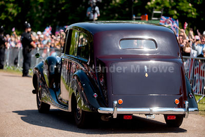 Megham Markel and mother drive down The Long Walk to St George's Chapel in the Queen's vintage Rolls-Royce Phantom IV