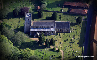 aerial photograph of f the medieval  St Nicholas Church Dersingham  Norfolk England UK