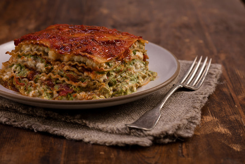 Rustic lasagna dish styled and photographed for lifestyle food brand by Jason Tinacci