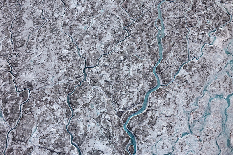 Aerial view of meltwater channels in ice cap north-east of Sermeq Kujalleq Glacier, Sermersuaq / Greenland ice sheet, Greenland, August 2014.