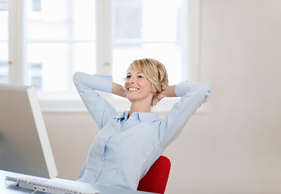 Young woman relaxing at desk