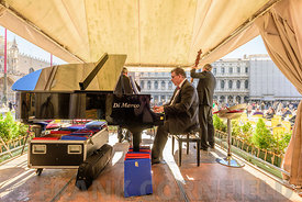 VENICE, ITALY - OCTOBER 23, 2017:  Musicitions playing on a bandstand at the Piazza San Marco in Venice, Italy on a sunny morning.