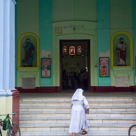 A nun walks to service at The Sacred Heart Church