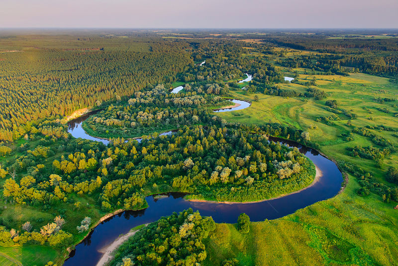 Aerial view of Rver Koiva, and the border between Estonia and Latvia in Southern Estonia, Valgamaa, Estonia. August 2014. Estonia is on the left side of the river and Latvia on the right bank.