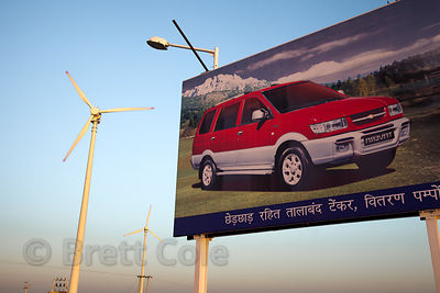 A car billboard in front of windmills in the Thar Desert near Jaisalmer, Rajasthan, India