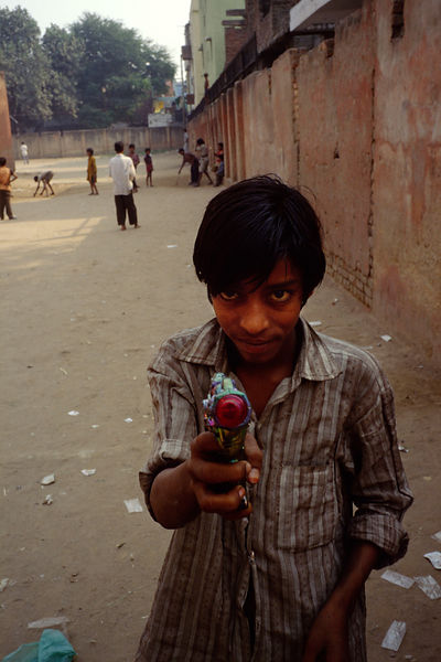 India - New Delhi - Boy with a toy gun