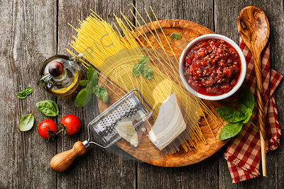 Ingredients for spaghetti bolognese on gray wooden background