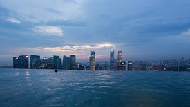 Bird's Eye: Medium Shot At The Edge Of A Singapore Infinity Pool