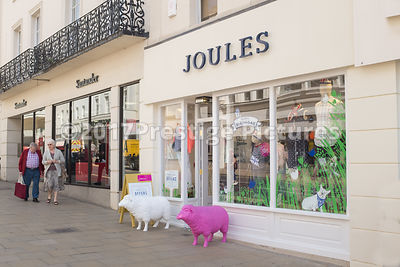Clothes Shop Joules with a White and a Pink Model Sheep Outside