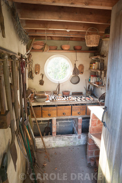 Inside the potting shed with circular window. York Gate Garden, Adel, Leeds, Yorkshire