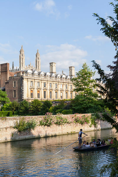 Punts and passengers glide past The Clare College (founded 1326) on the  River Cam past the Garret Hostel bridge