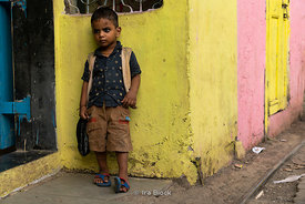 Portrait of a kid at Dhobi Ghat, a laundry district in Mumbai, India.