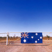 Cattle station fence with Australian flag on gate near the Barrier Highway, Route 32, New South Wales, Australia