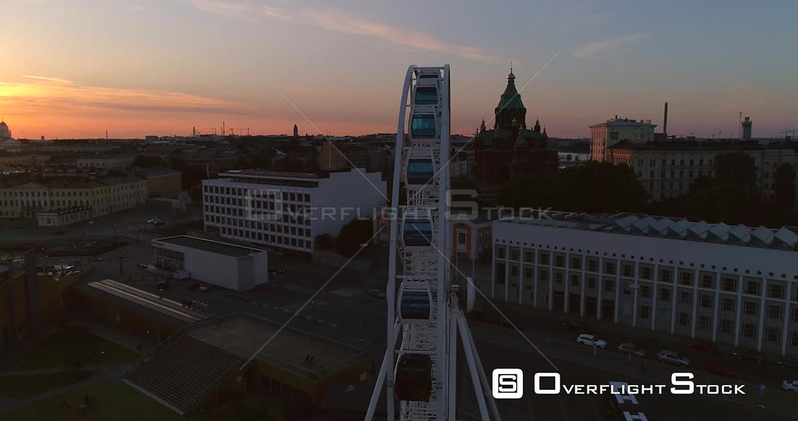 Sunset City, Aerial View Around the Helsinki Skywheel Ferris Wheel, Revealing the Market Square and South Harbour, on a Sunny Summer Evening Dusk, in Helsinki, Uusimaa, Finland