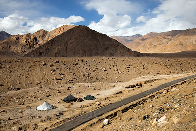 Tents housing immigrant construction workers at 11,000 feet in the Himalayan desert near Nimmu, Leh, Ladakh, India