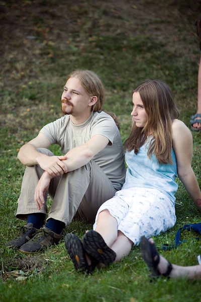 Hungary - Pecs - A young couple listen to a traditional folk music concert