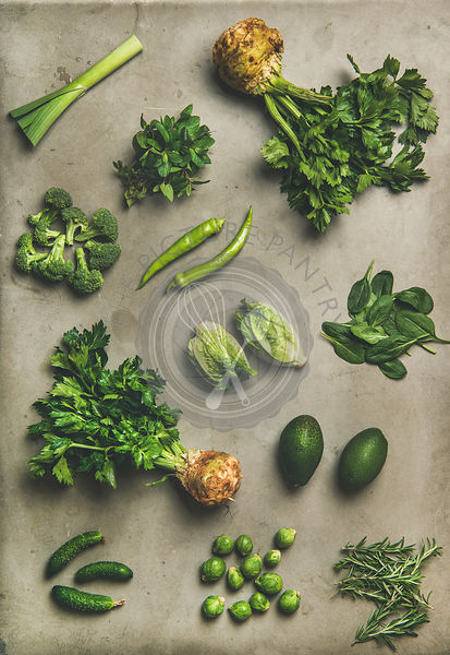 Healthy vegan salad ingredients layout over concrete table background