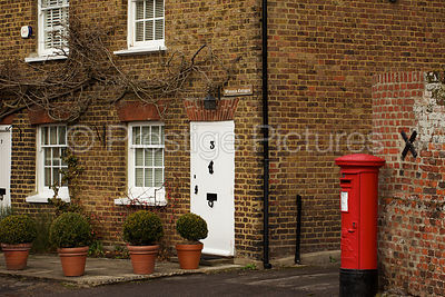 Old House in A Buckinghamshire Village with a Red Post Box