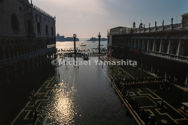 Piazza San Marco floods due to the high tide from the Adriatic Sea known as acqua Alta. Venice, Italy, 1993.