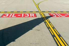 A Shadow of an airplane wing on the runway at JFK, New York.
