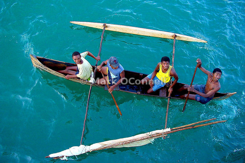 Boys in a Pirogues boat Madagascar