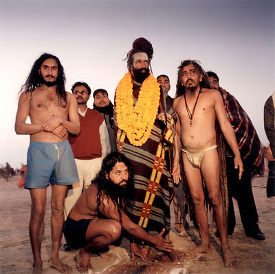 Devotees and their saddhu at the Kumbh Mela