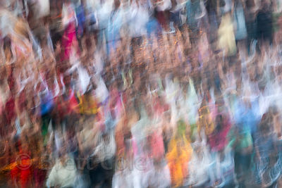 Impressionistic view of a crowd observing Diwali in Haridwar, India, made by moving the camera during a long exposure