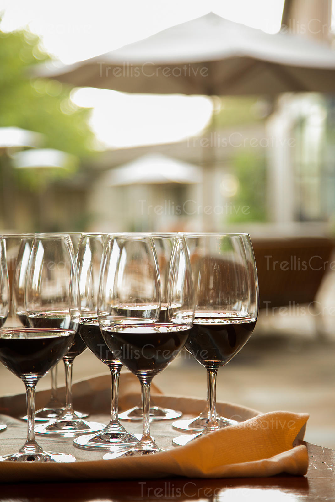 Close-up of red wine glasses on restaurant table