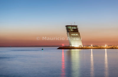 The Tower of Maritime Control in Alges at dusk, overlooking the Tagus river and the Atlantic Ocean. A contemporary project by architect Gonçalo Byrne. Lisbon, Portugal
