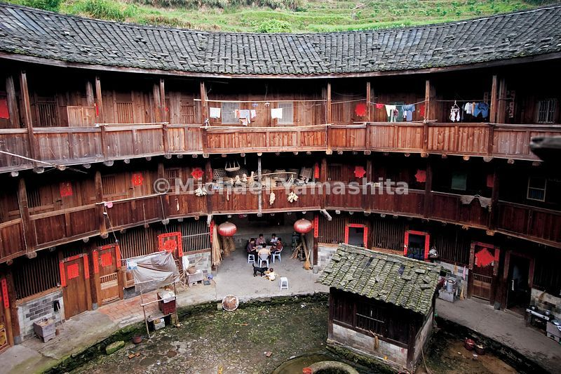 "The Hakka, Southeast Asia's most prominent imigrant group, began emigrating from China soon after Zheng He's last voyage. They still live in this ancient style of communal housing, calld ""earth buildings."""