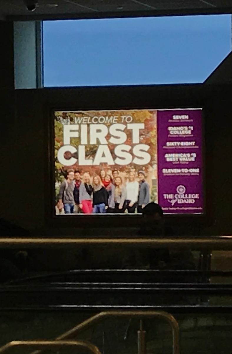 "The College of Idaho's ""First Class"" ad at Boise airport"