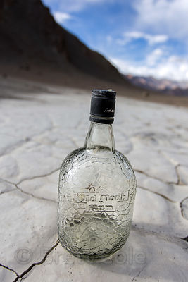 "Empty ""Old Monk Rum"" bottle on the Himalayan plain at 12,500 feet near Nimmu, Ladakh, India"