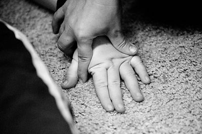 A conductor flattens the hand of a child
