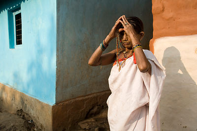 A tribal woman prays