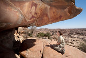 Tourist looking at Las Geel rock-art, Somaliland, Somalia