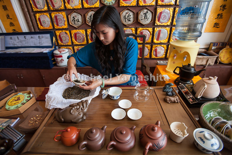 A tea master performs an elaborate Gong Fu tea ceremony at a retail shop in Puer.