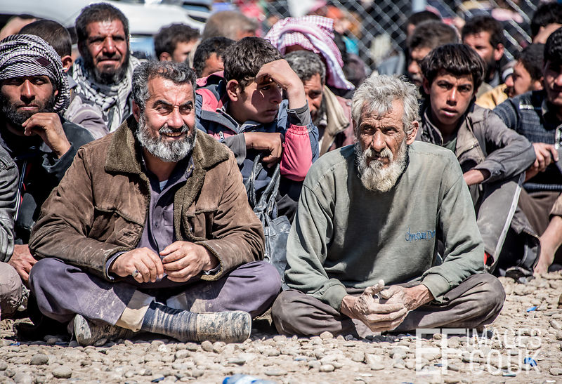 Men Sitting Waiting To Go Through A Security Check To See Whether Or Not They Are Members Of ISIS. At Hamam al Alil IDP Camp, Near Mosul