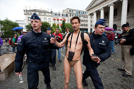 19 Jun 2010 - Brussels (Belgium) - A man who tried to demonstrate at the Cyclonudista ride wearing bath clothes is arrested by the Police. The Cyclonudista is a collective bike ride of people naked hold every year in big cities of Europe to demand less car trafic and the transformation of public space into room for living. © Bernal Revert/ Isopix
