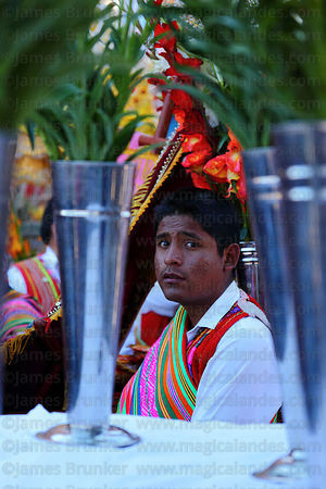 Indigenous bearer waits for parades during Corpus Christi festival , Cusco , Peru