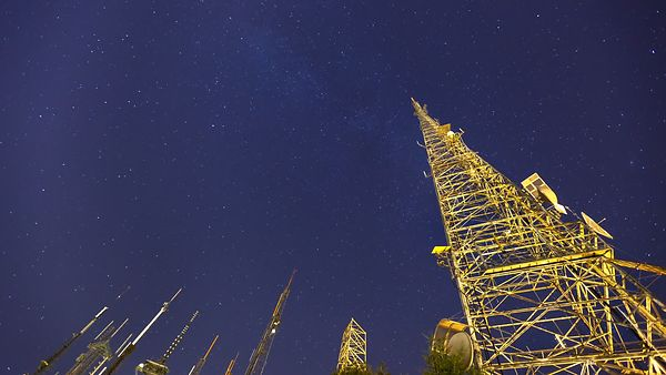 Medium Shot: Star Rotation Over Communication Towers